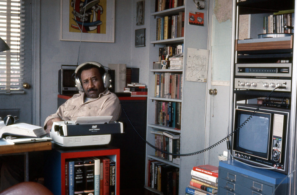 Albert Murray listening to see if the music swings (c. 1970)