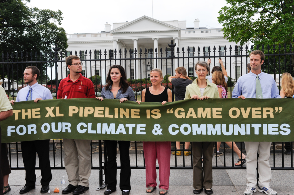 Protesters of the Keystone XL Pipeline hold a banner in front of the White House before the sixth day of arrests on August 25, 2011 in Washington. Rena Schild/Shutterstock