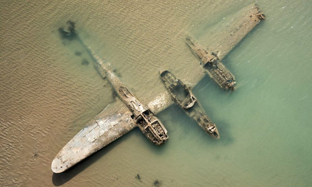 This Lockheed P38F-Lightning, landed almost on the sands at Harlech, Wales, in September 1942, and is now a designated site of historical and archaeological interest. Usually it's underwater, or buried by the shifting sands. Sometimes it pokes its fins up above the water (2007 / 2019).