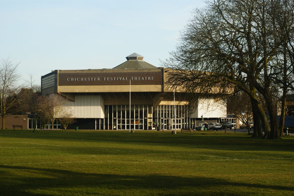 """""""Chichester Festival Theatre, Sussex"""" by Peter Trimming; white, brown, and green building with green dome roof and white checkerboard windows in front."""